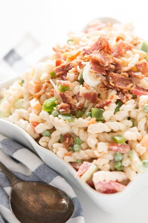 Every summer we love to try out new pasta salad recipes, but this easy pea pasta salad remains one of our favorites year after year! gluten-free