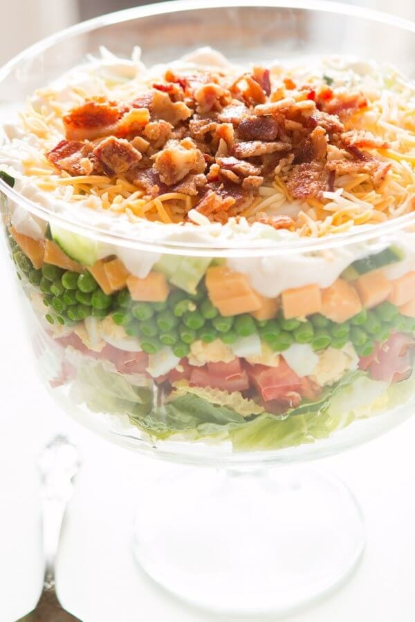 Everyone needs a great recipe for the classic 7 layer pea salad! This one is my favorite because that dressing isn't the typical sour cream. gluten-free, grain-free