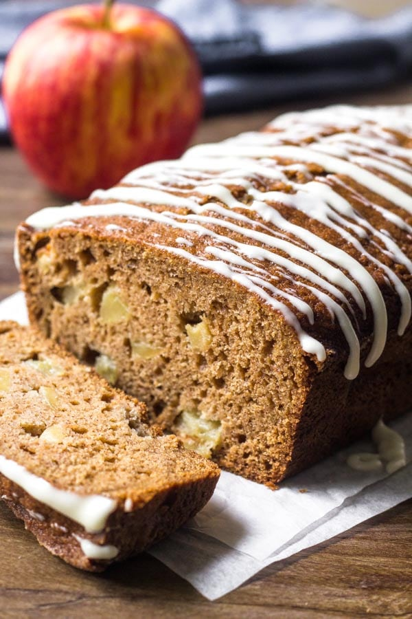 This moist apple bread is filled with brown sugar, spices & tons of apple pieces. Then it's topped with cream cheese glaze for the perfect apple treat.