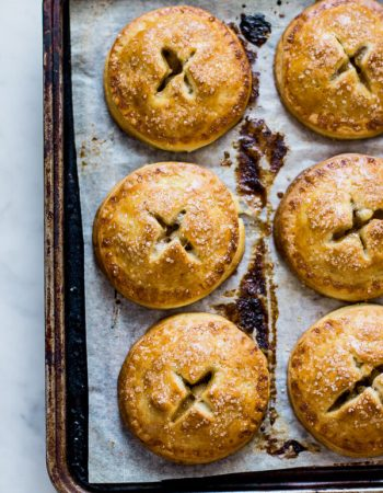 Apple pie is an all American classic but want to really blow it out of the park? Make these darling apple hand pies for your guests! ohsweetbasil.com