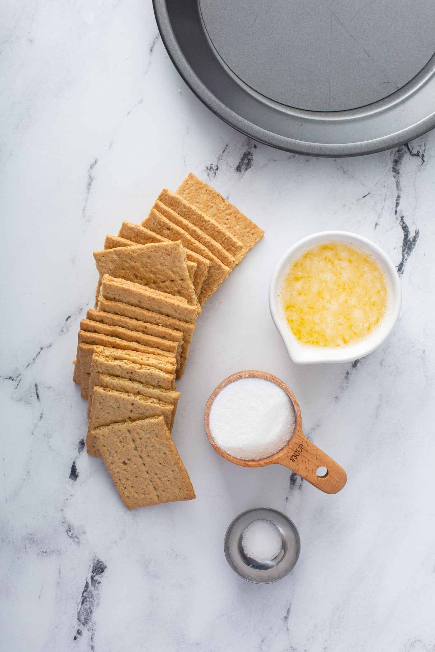 Graham crackers and containers of sugar, and melted butter.