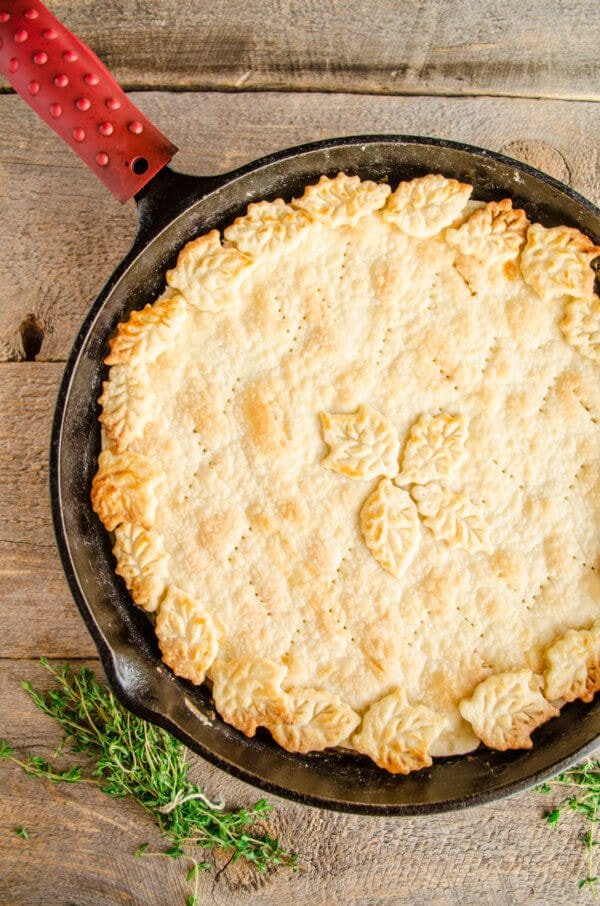 A 30 Minute Skillet Beef Pot Pie fresh from the oven sits on a table waiting to be eaten.