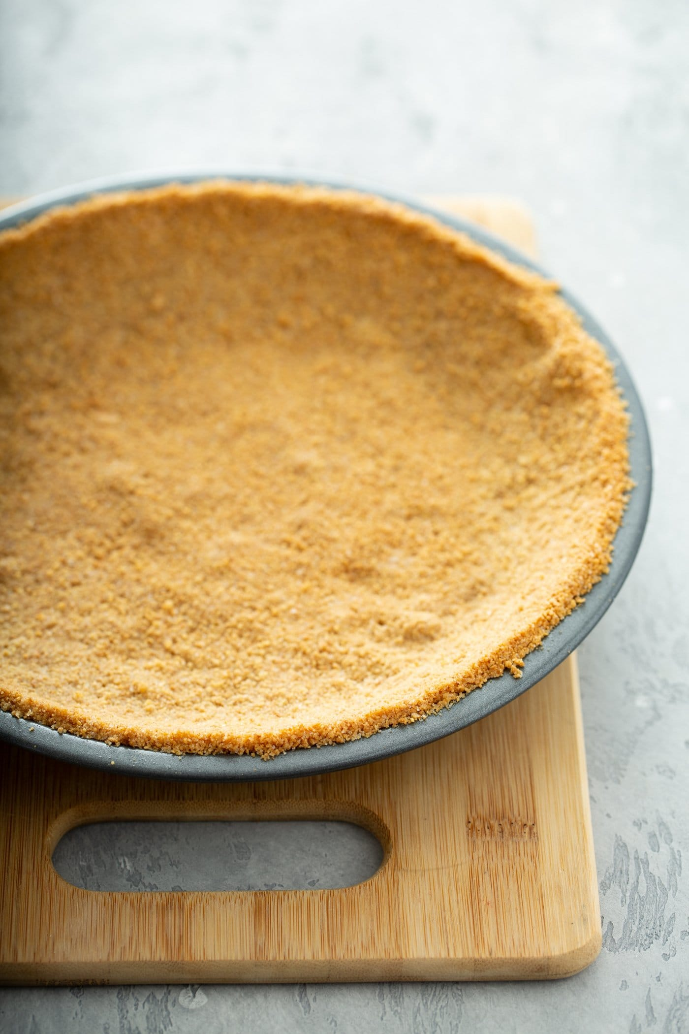A graham cracker crust in a pie pan.