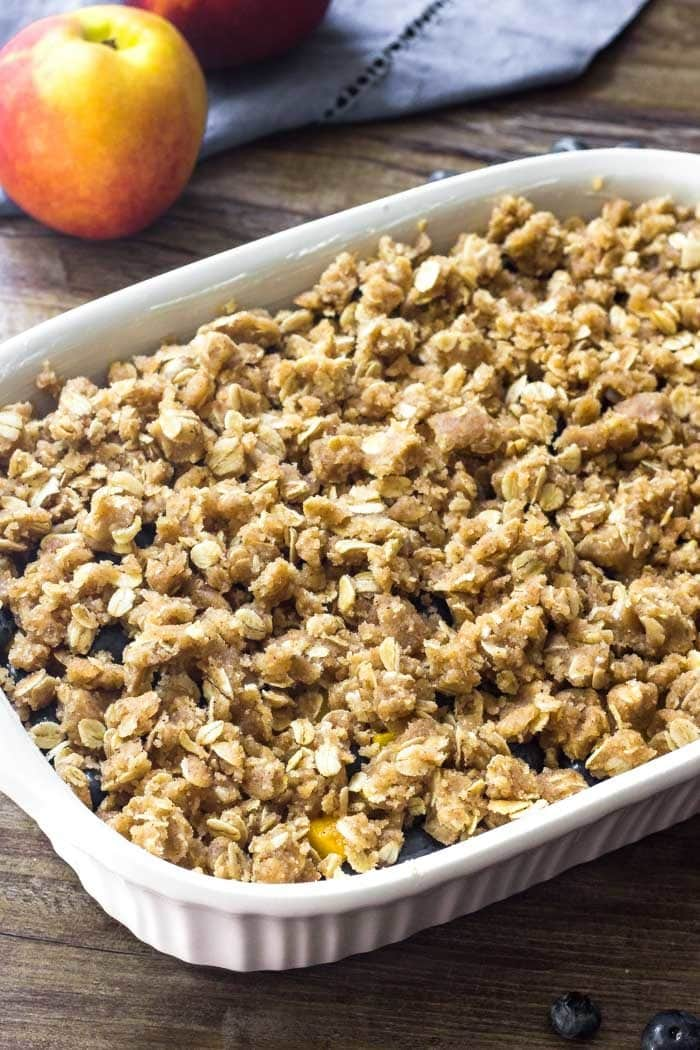 Blueberry Peach Crisp with oatmeal topping before it goes into the oven.