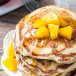 These brown sugar peach pancakes are light & fluffy with golden edges and a delicious hint of brown sugar & cinnamon. Make them with fresh or canned peaches for the perfect breakfast pancakes.