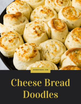 A pan of golden brown baked cheese doodle cheesy garlic bread. The cheese doodles are like cinnamon rolls filled with mozzarella cheese.