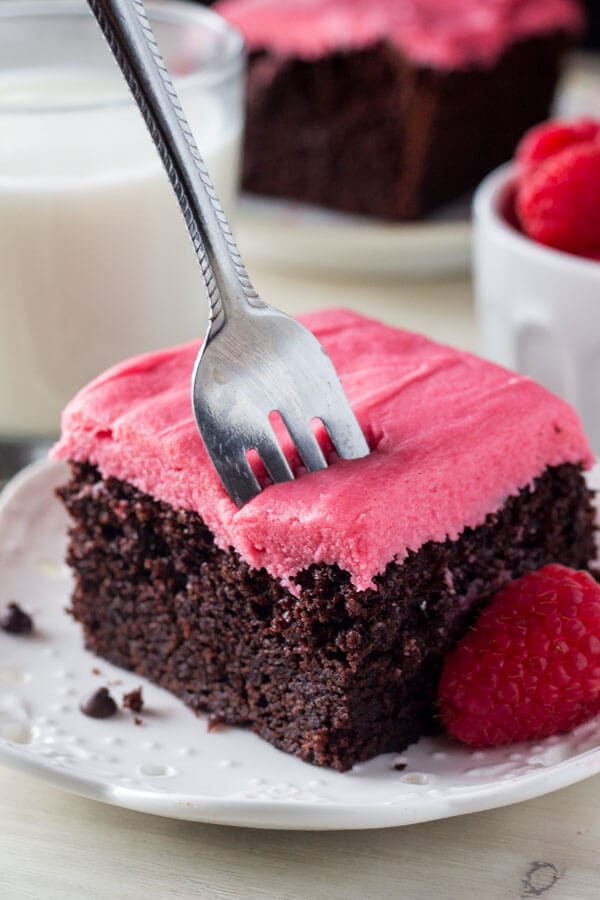 The chocolate cake is fudgy and super moist with a rich chocolate flavor, then the fresh raspberry frosting is pretty in pink!