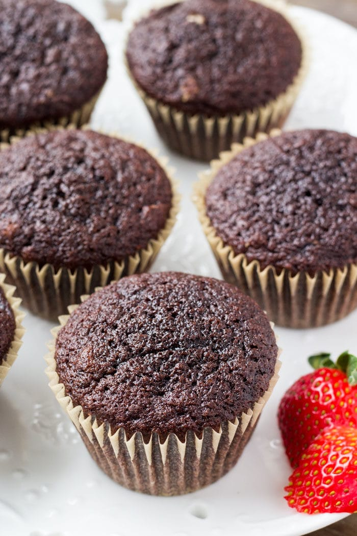 These chocolate cupcakes with strawberry frosting start with moist, fudgy chocolate cake. Then they're topped with creamy strawberry buttercream made from real strawberries.