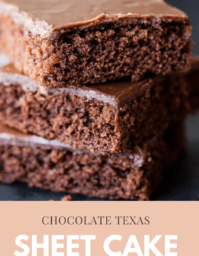 A stack of chocolate texas sheet cake cut into squares