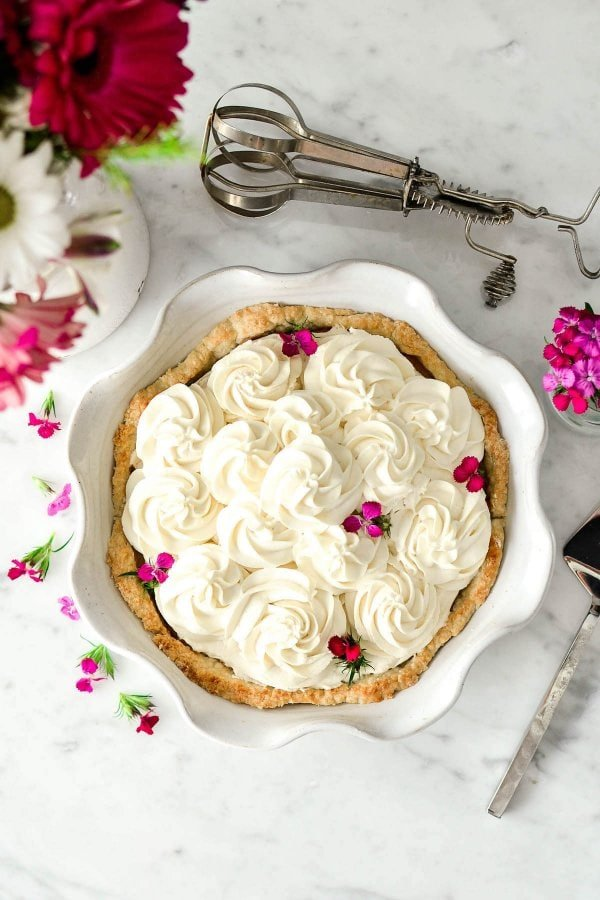 This Homemade French Silk Pie is made completely from scratch! A flaky pie shell is filled with an irresistibly chocolatey cream filling and topped with homemade whipped cream! The best part? It's even more delicious than the infamous version from Village Inn {or Baker's Square for my Midwest-dwelling friends}!