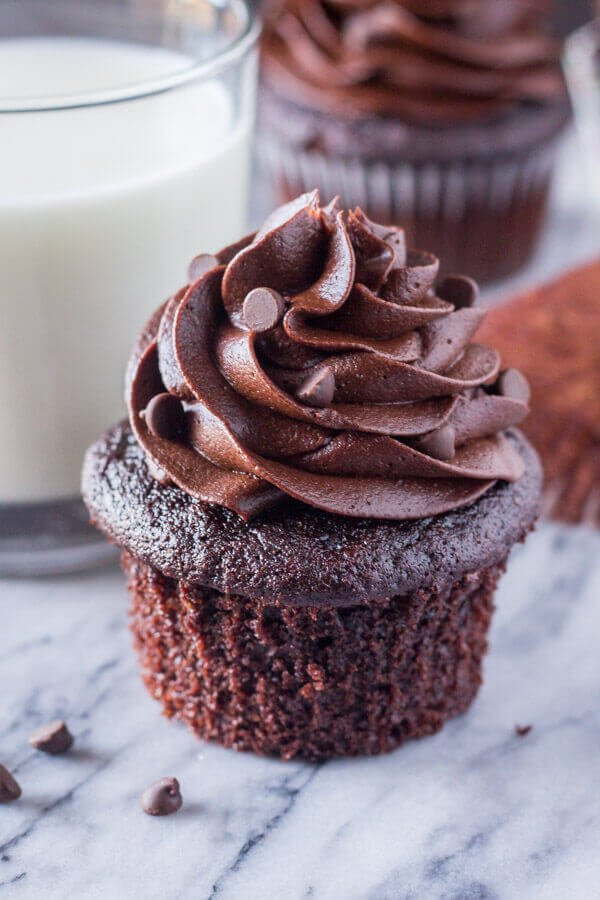 If you like a double dose of chocolate, try these moist chocolate cupcakes topped with creamy chocolate frosting!