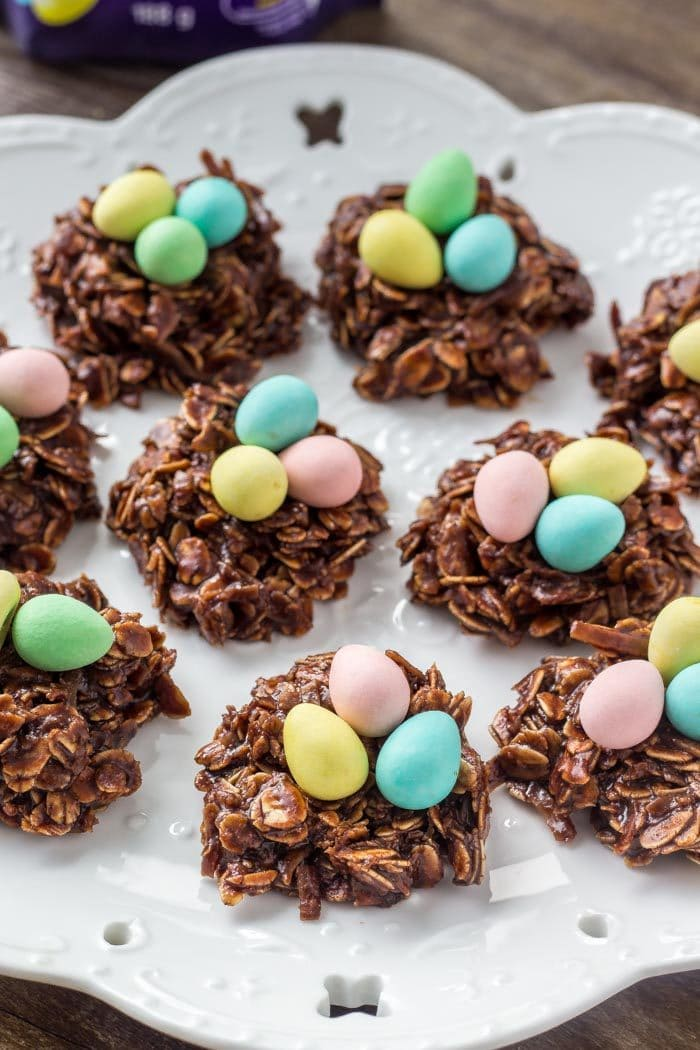A plate of Easter Nest Cookies topped with mini chocolate eggs.