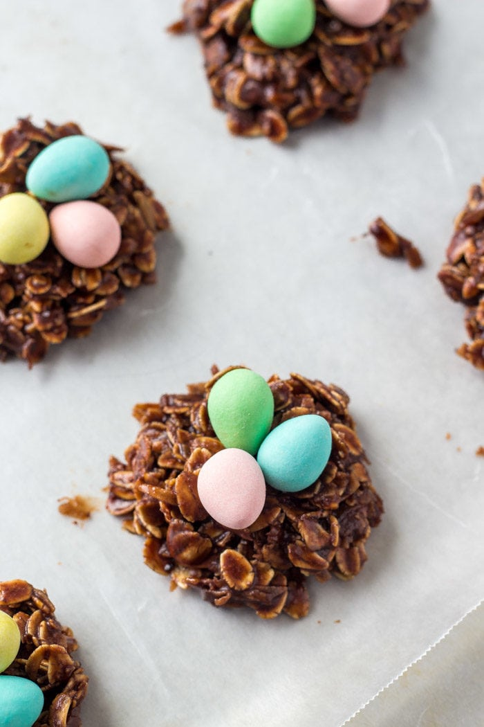Easter nest cookies with miniature eggs on a cookie sheet.