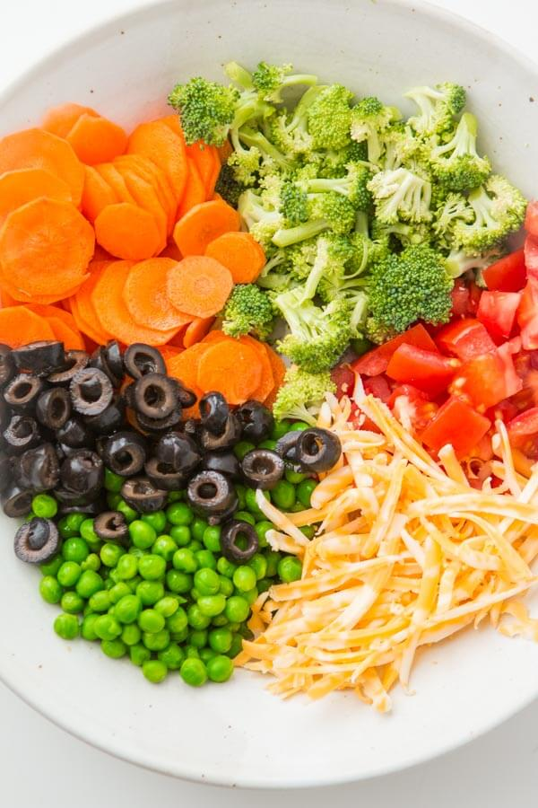 wondering what vegetables to put in pasta salad? Try this perfect combination! ohsweetbasil.com