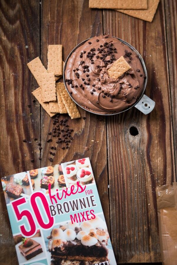 bowl of chocolate brownie dip next to cookbook