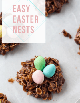 Easter Nest Cookies on a white plate topped with miniature eggs.