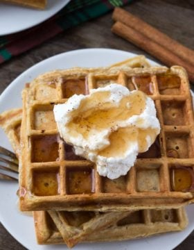 These fluffy eggnog waffles have soft centers, golden edges and a delicious hint of nutmeg. Top with maple syrup and whipped cream for the perfect holiday breakfast.