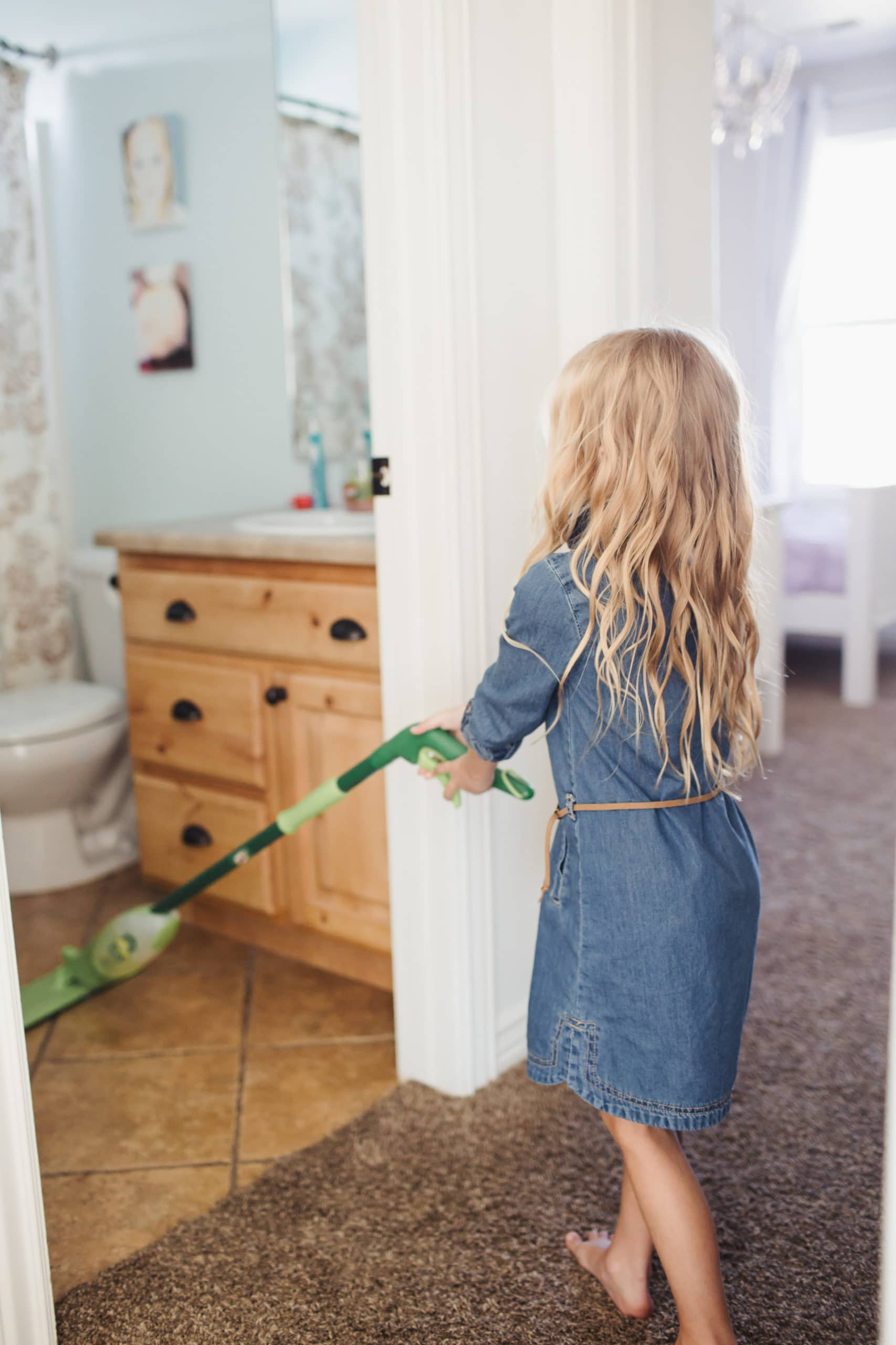 kids cleaning the house