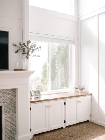 White Mantle with Shiplap and built in cabinets