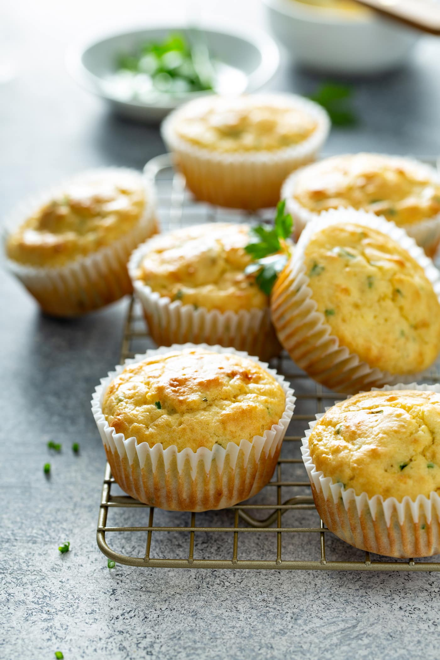 Seven feta muffins on a cooling rack.
