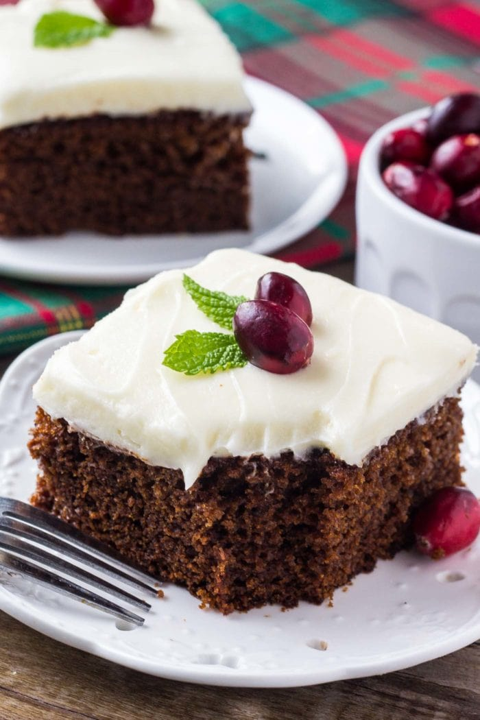slice of Gingerbread Cake with Cream Cheese Frosting on white plate