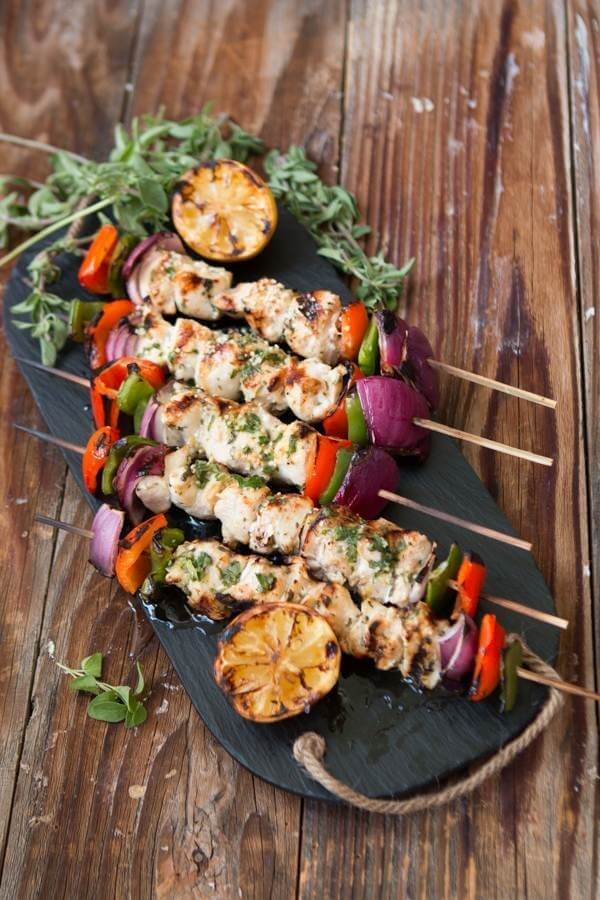 five greek souvlaki kabobs on serving tray