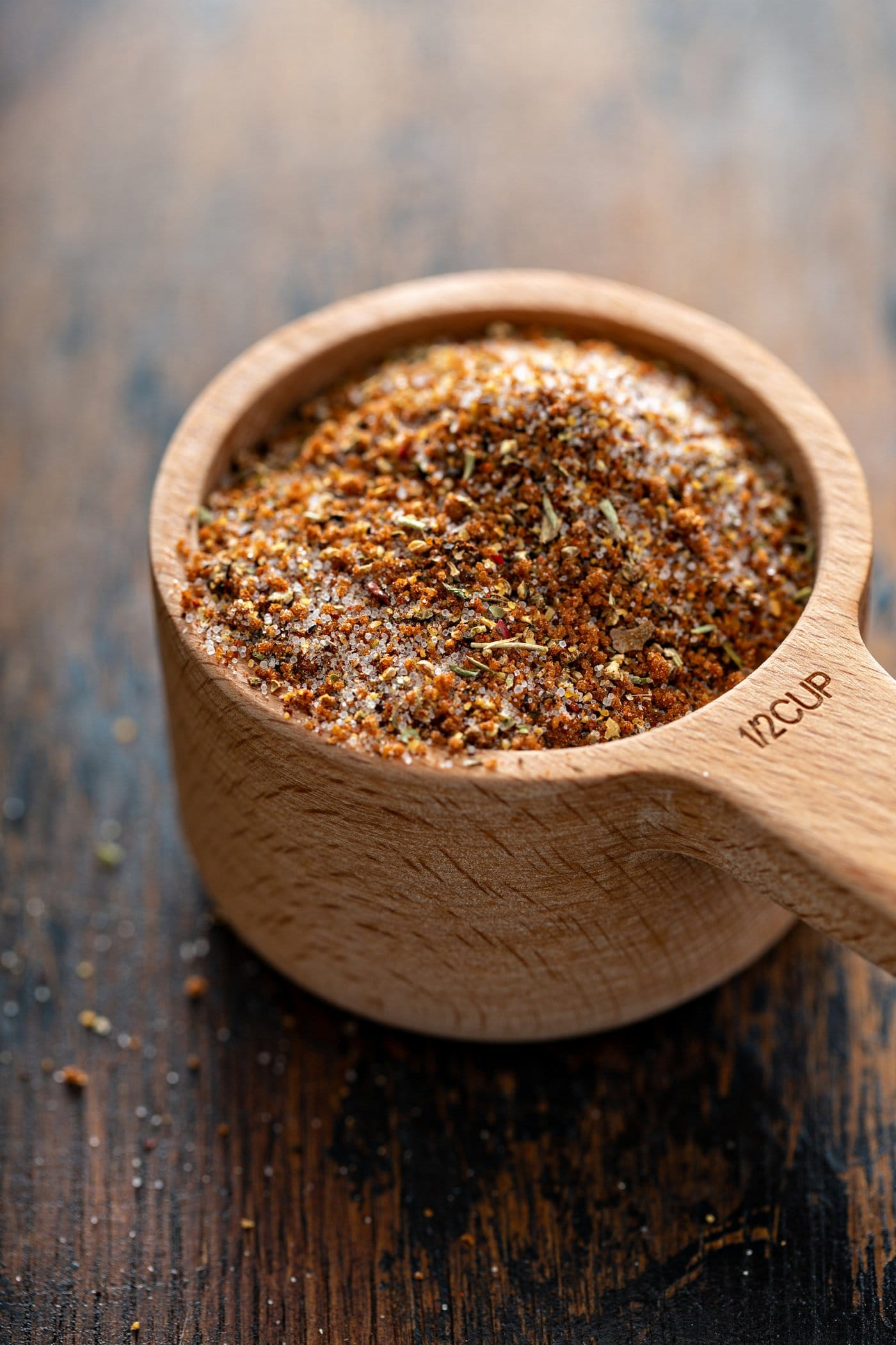 Rub for grilled ribs. The ingredients are mixed together in a measuring cup.