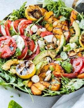 Well this is it. The most amazing caprese salad I've had and it's a grilled peach avocado caprese salad with a balsamic reduction and grilled lemons. It's so easy though! ohsweetbasil.com