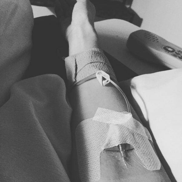 A photo of my arm with an IV in it.