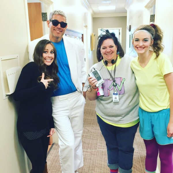A photo of me with my doctor and two nurses all in their halloween costumes.
