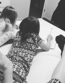 A picture of our two girls writing in their journals.