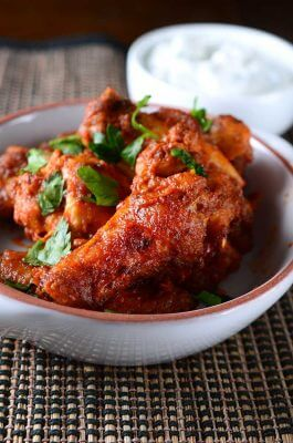 Crispy Baked Wings coated in a spicy harissa sauce