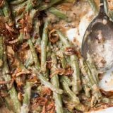 We all grew up on green bean casserole with cream of mushroom soup, but it's time to kick things up with Heritage Green Bean Casserole with Crispy Shallots. ohsweetbasil.com