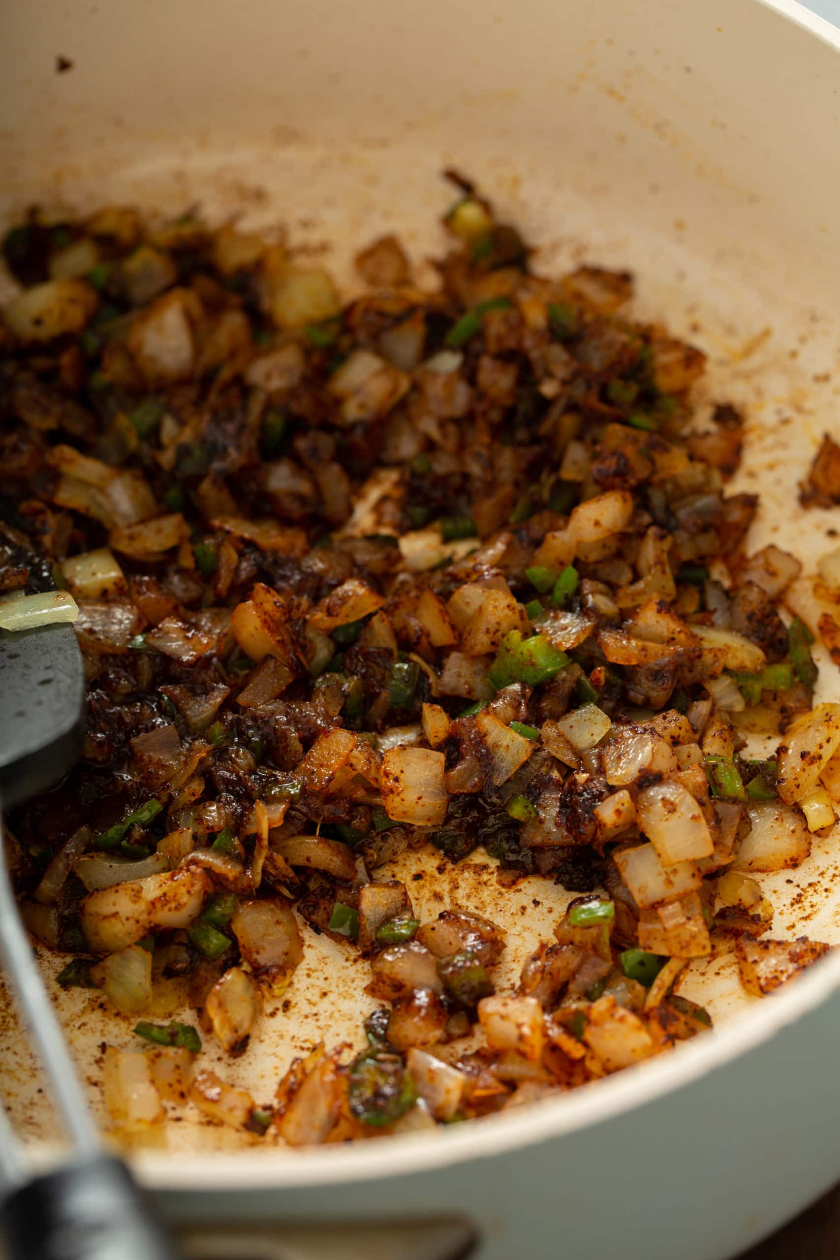 A skillet with sauted onions, jalapenos, and garlic.