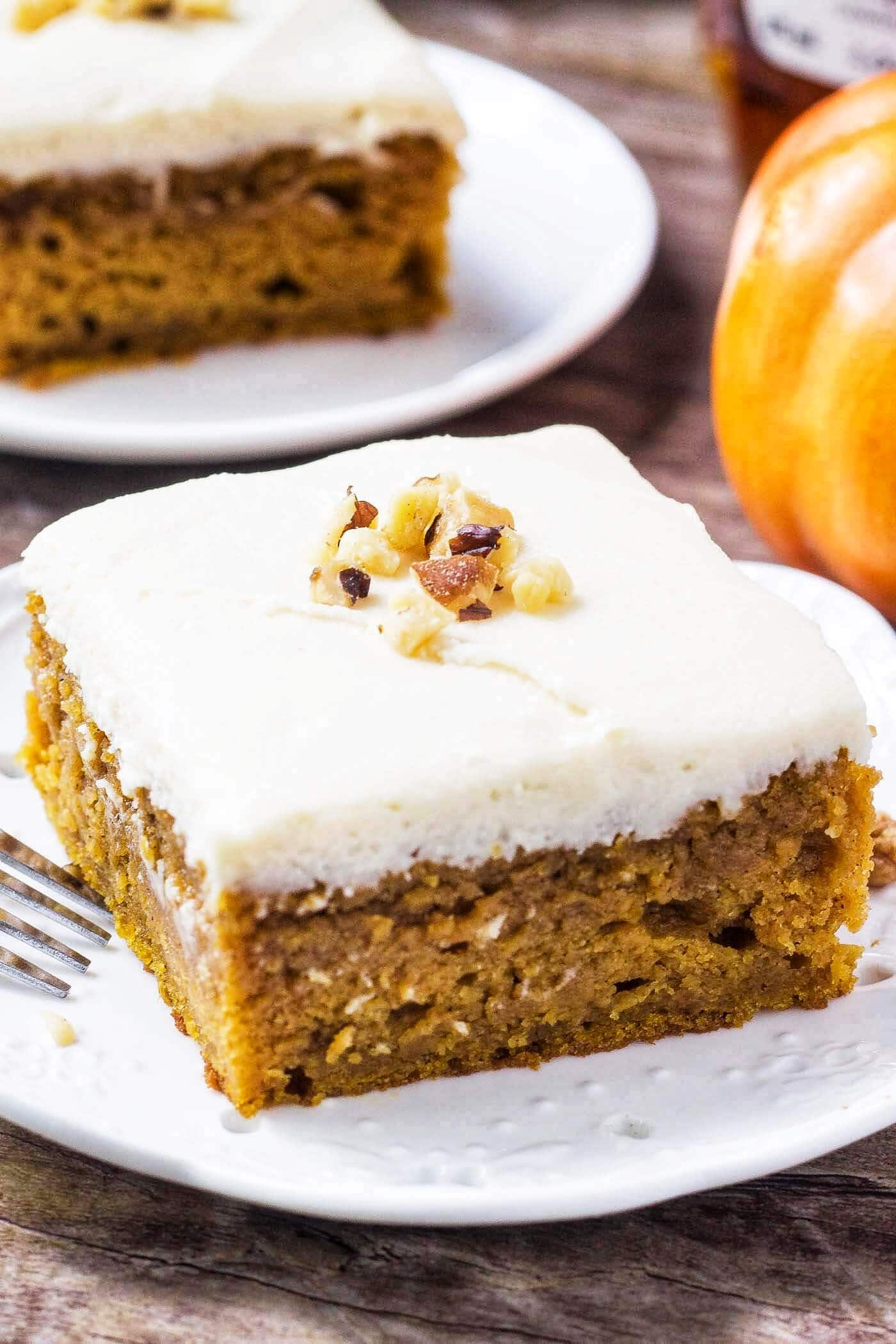 two slices of pumpkin cake on white plates