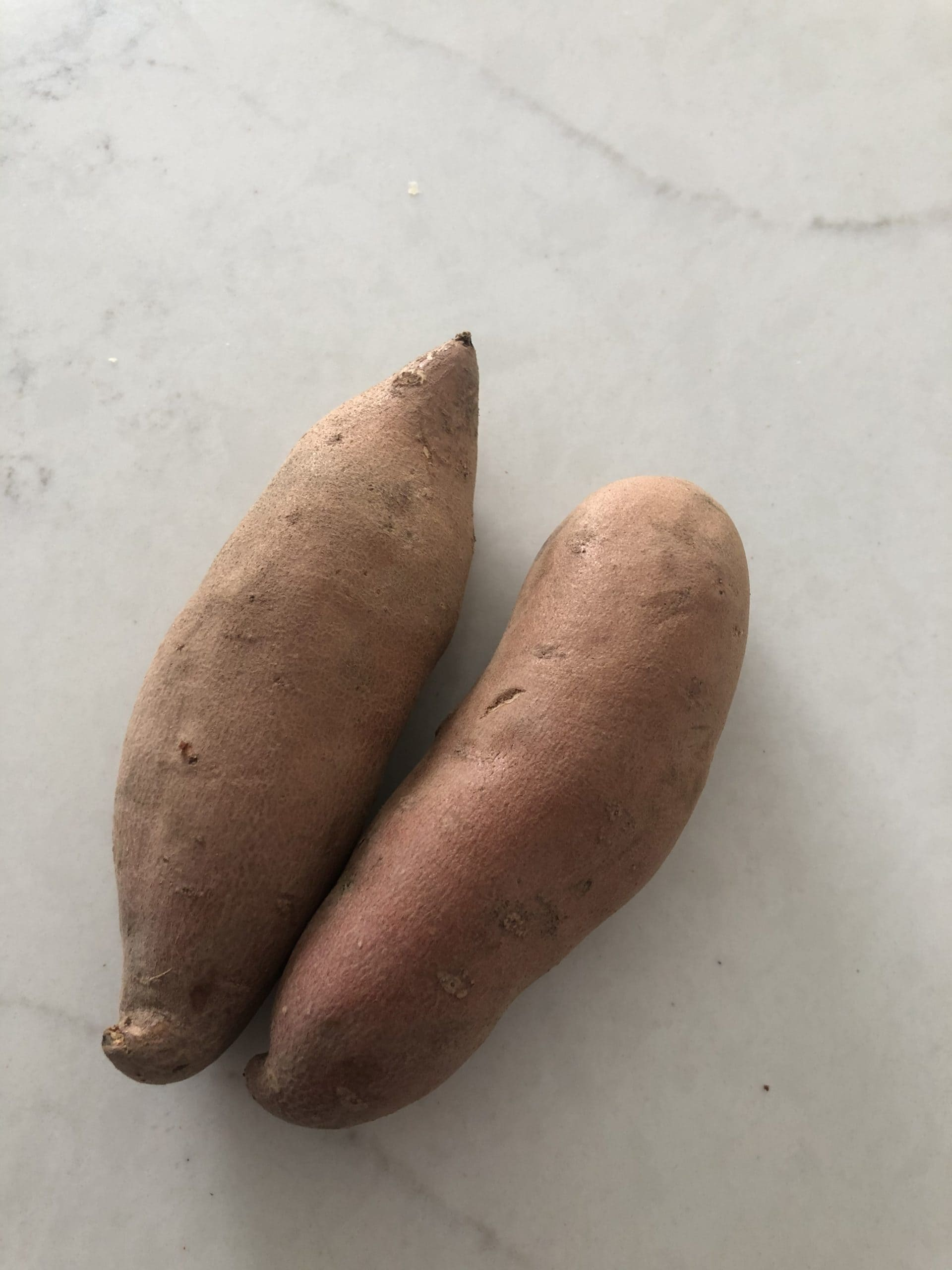 small sweet potatoes on a counter