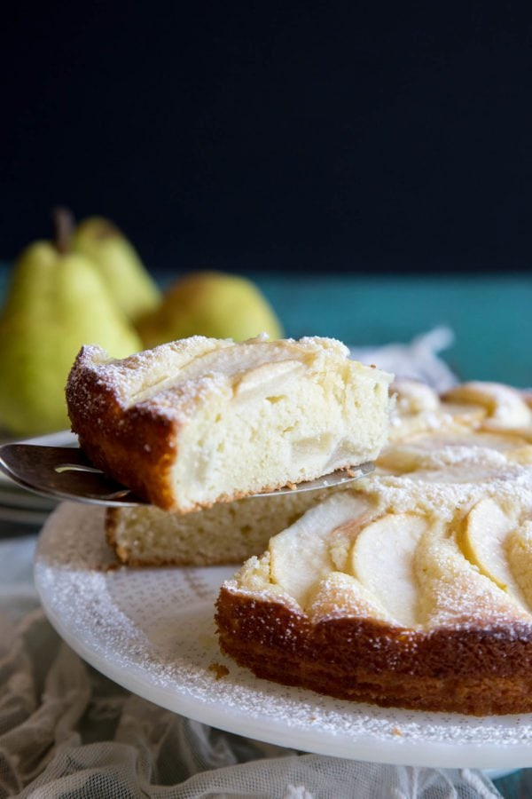 A slice of Italian pear cake being served