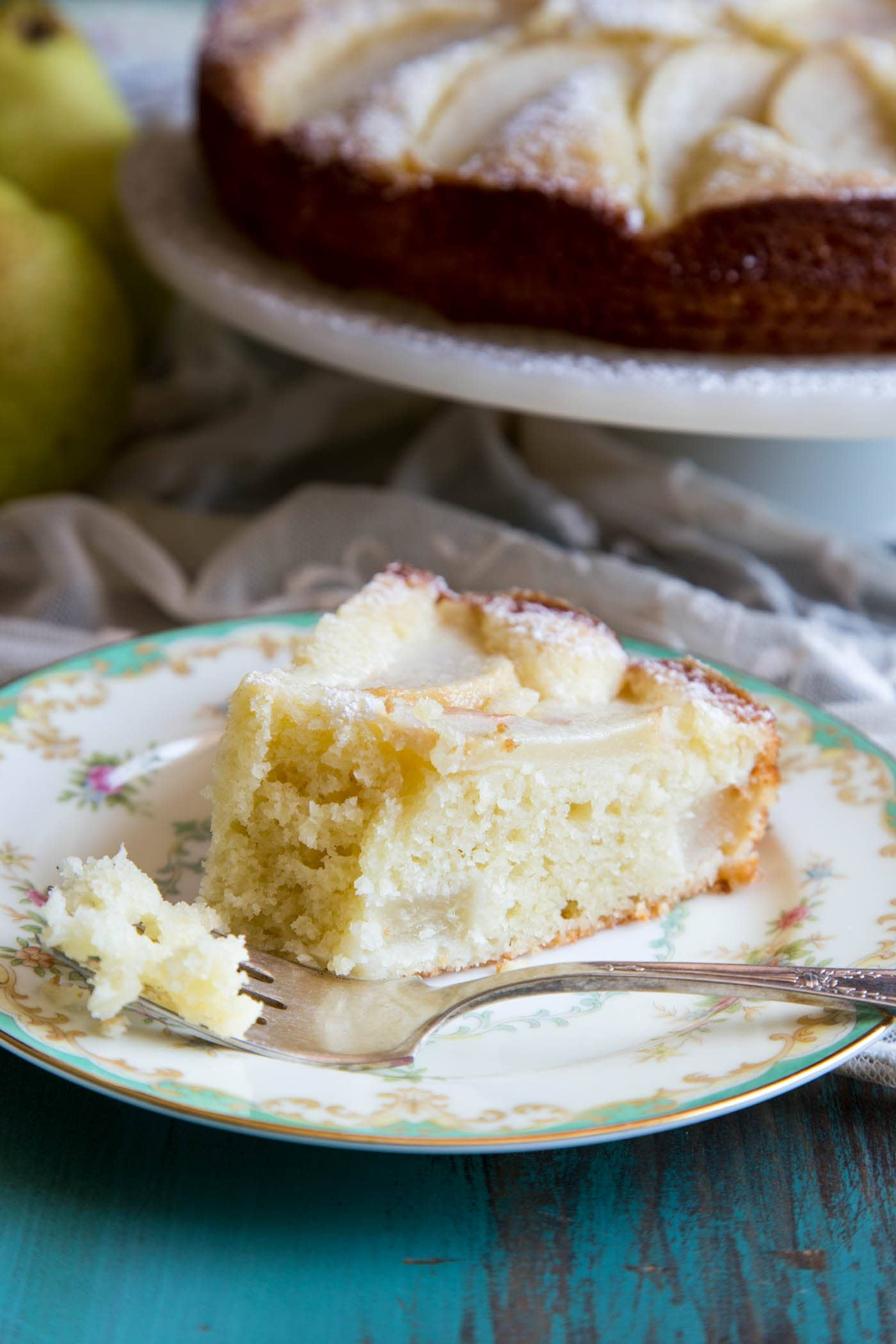 A slice of pear cake on a plate