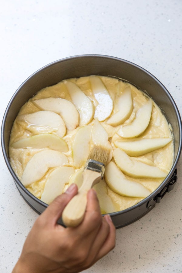 Brushing pears with butter before baking