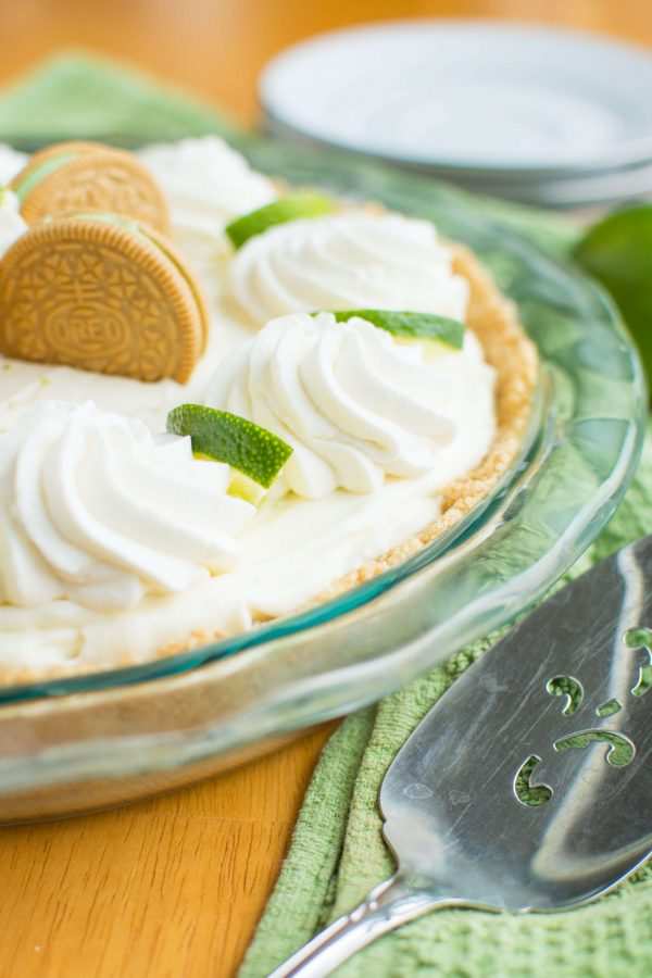 Key Lime Oreo Truffle Cream Pie. A no-bake pie that starts with a graham cracker crust filled with a layer of rich Key Lime Oreo truffle filling and a layer of tangy white chocolatey mousse filling!