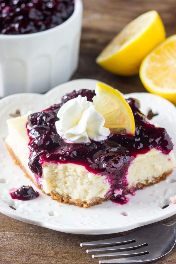 Lemon blueberry cheesecake squares are smooth & creamy with a delicious lemon flavor and crunchy graham cracker crust. The blueberry sauce makes them extra special!