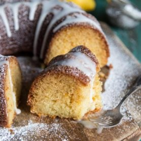 A slice of lemon bundt cake with glaze