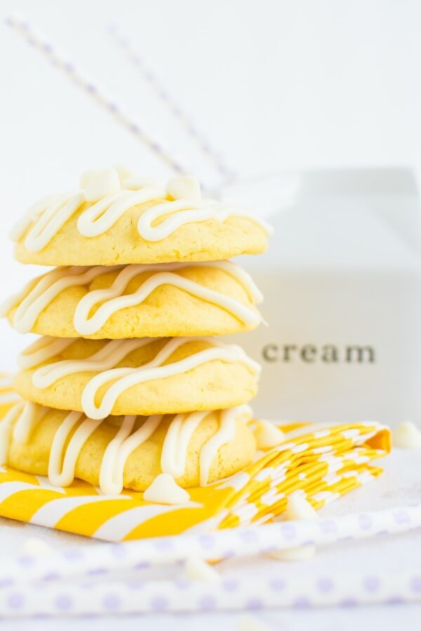 Soft and chewy lemon cremesicle cookies stuffed with a sweet, tangy cream cheese filling and drizzled in white chocolate!