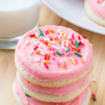 Make Lofthouse sugar cookies at home! These sugar cookies have a delicious buttery vanilla flavor, delicate crumb, and melt in your mouth. Then they're topped with creamy frosting & tons of sprinkles.