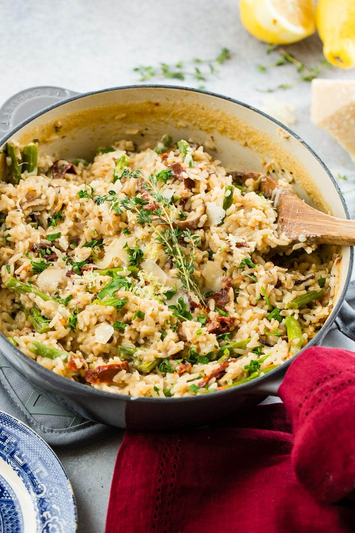 The holidays are busy enough without adding in all of the cooking and family dinners. Make ahead one pot creamy winter asiago cheese rice with asparagus!