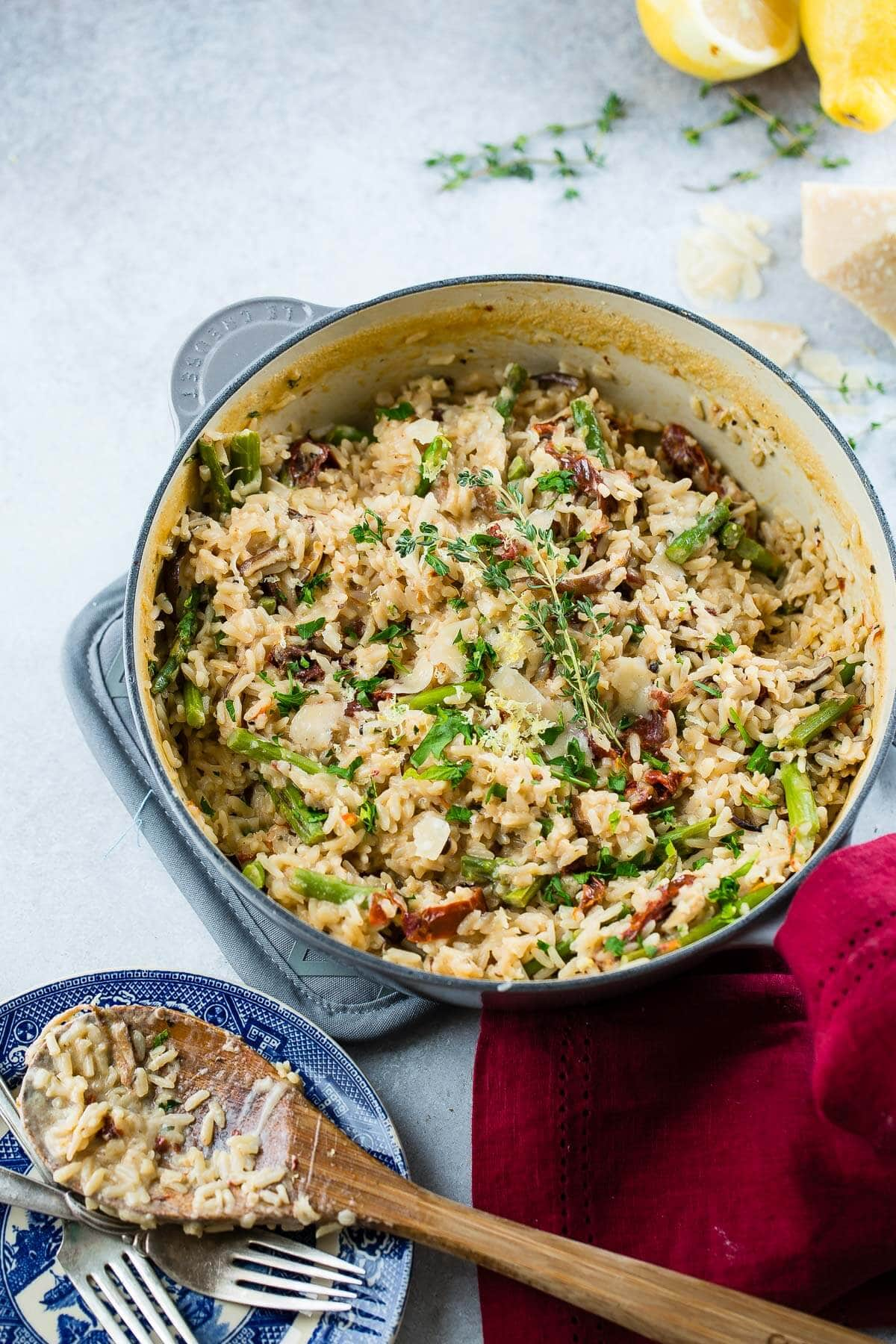 Making sides for thanksgiving or any holiday can be overwhelming but this make ahead one pot creamy winter asiago cheese rice is not only a great side, it's leftovers can be used to make a whole new dish! ohsweetbasil.com