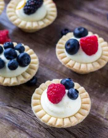 Mini fruit tarts with fresh berries and sweet vanilla filling.