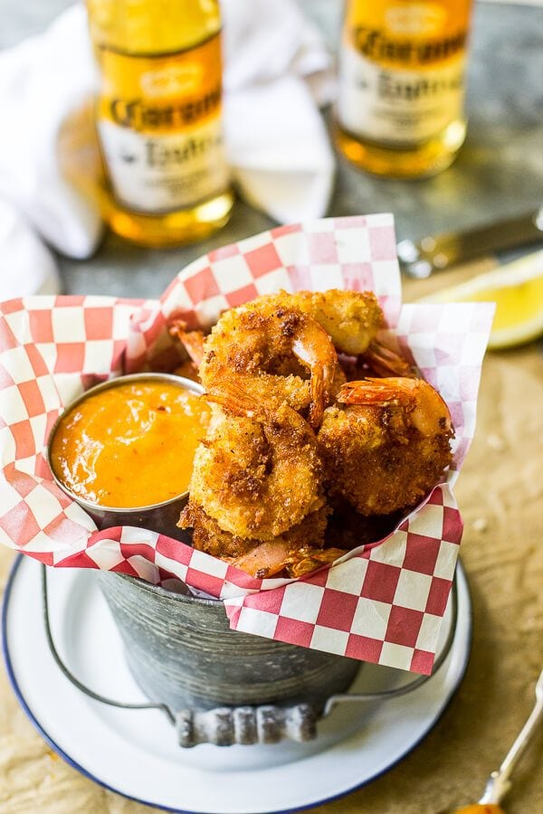 These Popcorn Shrimp with Mango Chipotle Sauce are the perfect summer appetizer! The shrimp are crispy and packed with flavor alongside a sweet and spicy summery sauce for dipping.