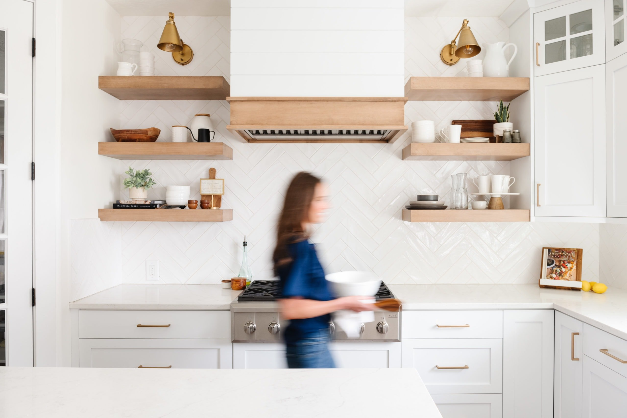A photo of a woman blurry with movement in the kitchen.