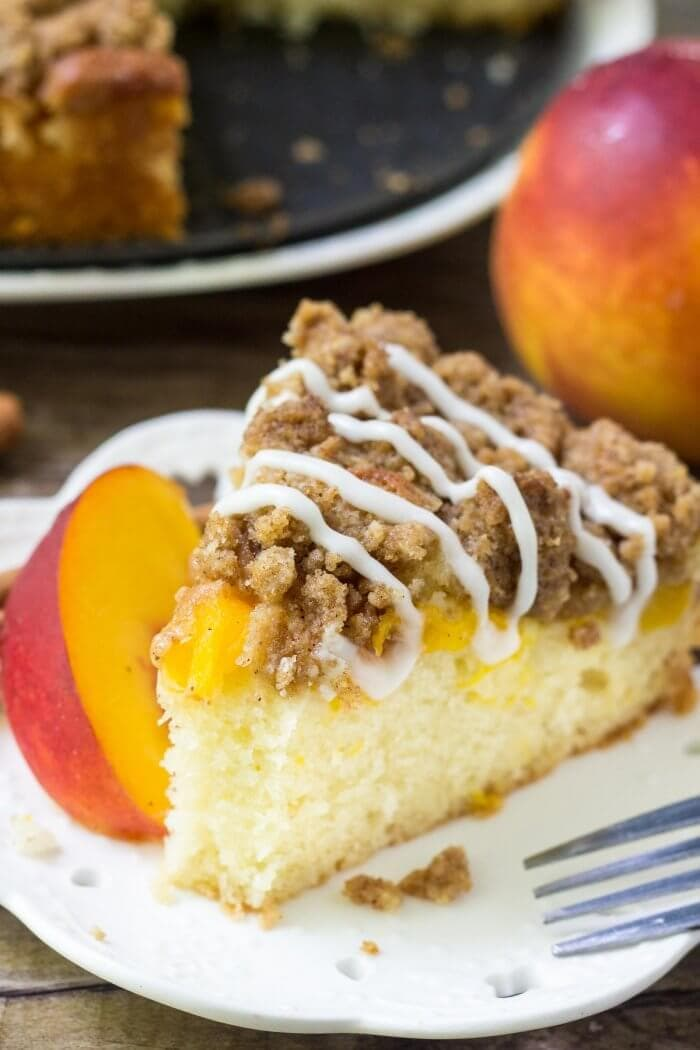 This Peach Coffee Cake with streusel topping is the perfect recipe for late summer. Moist vanilla cake, juicy peaches and crunchy cinnamon streusel. Make it with fresh or canned peaches - either way, you'll love this easy coffee cake recipe.